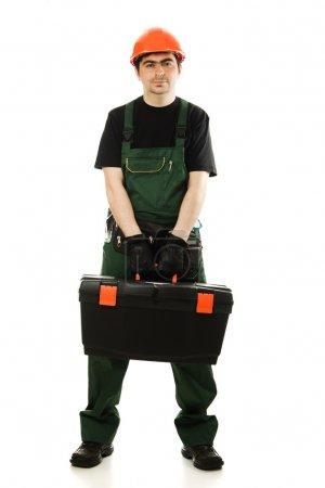 Photo pour Homme de service portant casque et tenant dans l'ensemble boîte à outils noir sur blanc - image libre de droit