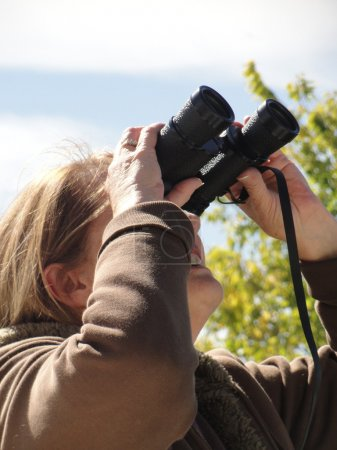 Female with binoculars.