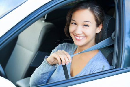 Always fasten your seatbelt. Girl in a car