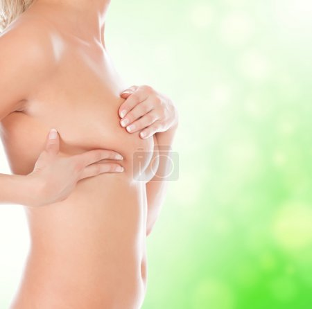 Breast cancer, woman touching her breasts