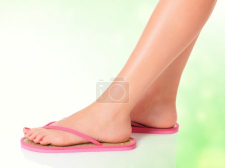 Feet in pink sandals