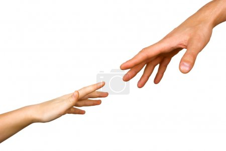 Small child's hand reaches for the big hand man