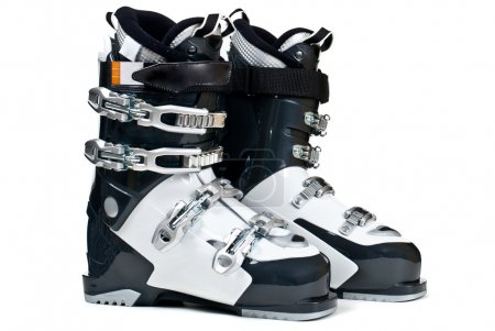 Modern professional ski boots isolated on white background
