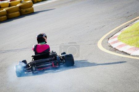 Driver on kart circuit