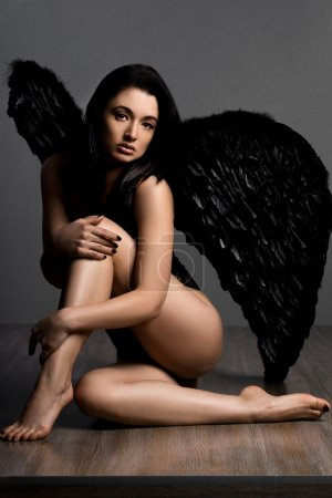 Angel with wings in grey background