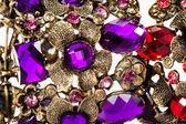 Close-up of violet and red bracelet