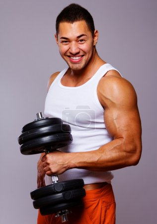 Portrait of young man lifting weights