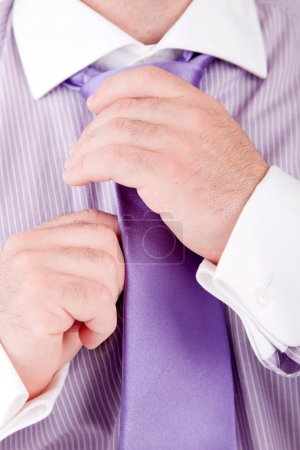 Photo for Business man fixing his tie, isolated over white - Royalty Free Image