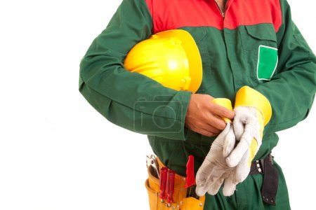 Worker holding helmet