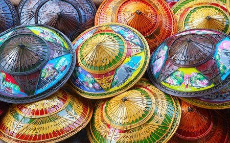 Photo for Group of colorful rice straw hats on the floating market - Royalty Free Image