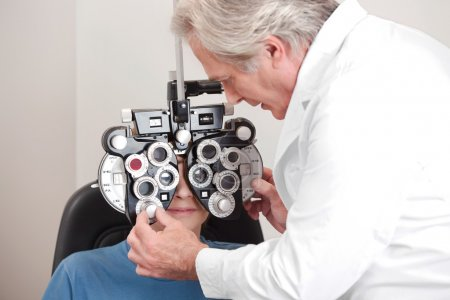Optometrist doing sight testing for pateient...