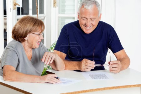 Photo for Happy senior couple playing leisure games at home - Royalty Free Image