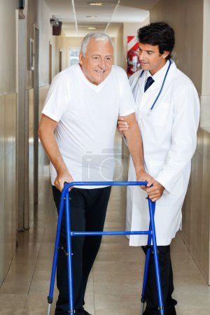 Doctor Assisting Old Man On a Walker