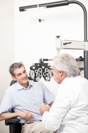 Optometrist doing sight testing for pateient....