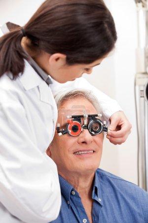 Man Wearing Trial Frames For Eye Treatment