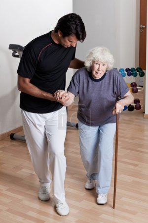 Therapist helping Patient To Walk