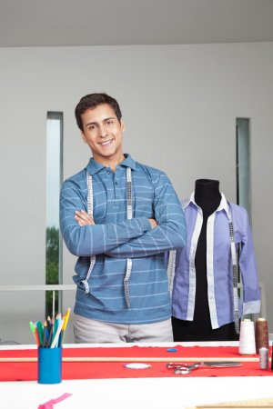Tailor Standing Arms Crossed