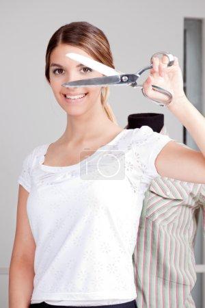 Female Dressmaker Holding scissors