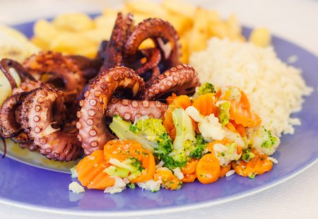 Grilled octopus with veggies and rice
