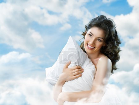 Photo for Girl holding a soft pillow - Royalty Free Image