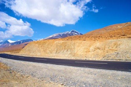 Yellowish mountain road view in tibet of China
