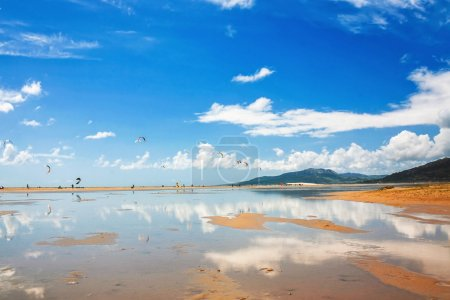 Photo for Tarifa beach in Spain packed with kitesurfers - Royalty Free Image