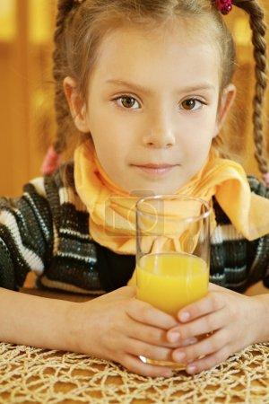 Girl-preschooler drinking orange juice