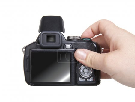 Hand holding camera isolated over white