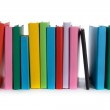 Stack of colorful books and E-book on white backgr...