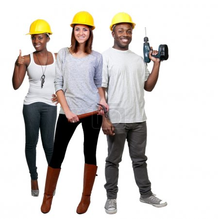 Photo for A black man and African American woman and caucasian woman construction worker a job site - Royalty Free Image