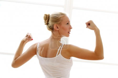 Young woman doing fitness exircises