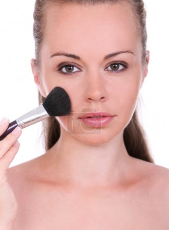 Beautiful woman with brush for make-up