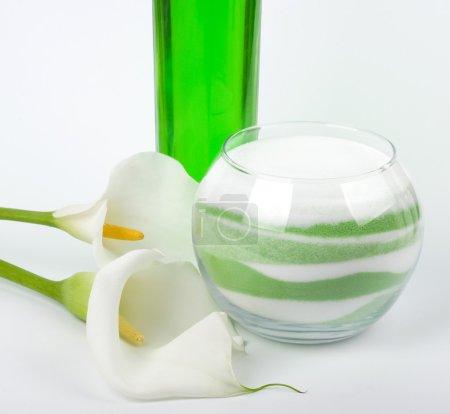 Beauty spa oils, white calla and salt on white background