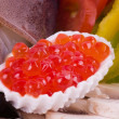 Red caviar and raw cocktail of seafood...