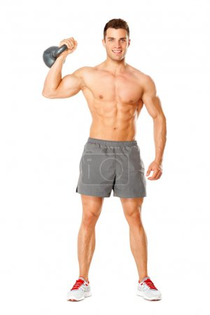 Full body of muscular man exercising with dumbbell on white