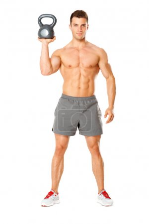 Handsome man working with kettlebell on white