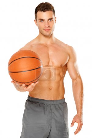 Handsome basketball player holding ball on white