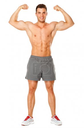 Full body of muscular man flexing his biceps on white