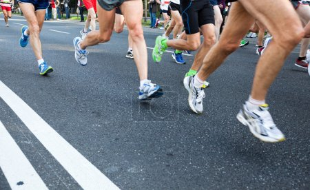 Photo for Running fast in a city marathon on street - Royalty Free Image