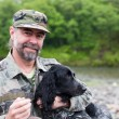 Middle aged man with a dog (Russian Hunting Spanie...