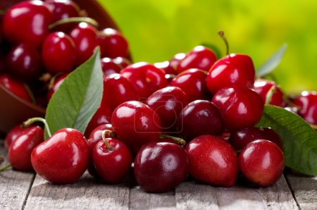 Photo for Fresh cherries on wooden table - Royalty Free Image