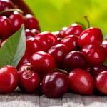 Fresh cherries on wooden table...