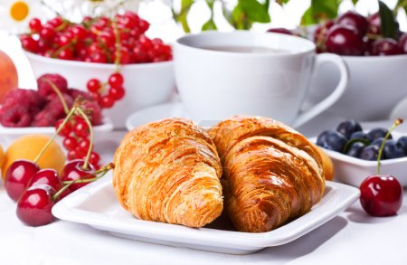 Photo for Breakfast with croissants, fresh berries and fruits - Royalty Free Image