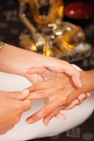 Photo for Relaxing massage therapy on a stretched hand - Royalty Free Image