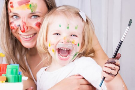 Photo for Happy mother and daughter with paint on faces - Royalty Free Image