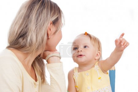 Mother and little daughter talking