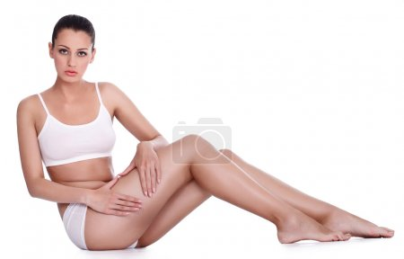Photo for Young attractive woman showing cellulite on her legs - Royalty Free Image