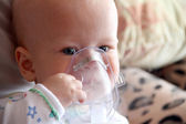 Baby in mask for inhalation