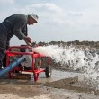 Worker puts into operation the mobile industrial w...