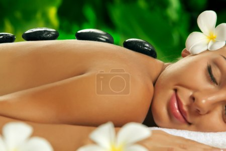 Photo for Portrait of young beautiful woman in spa environment - Royalty Free Image